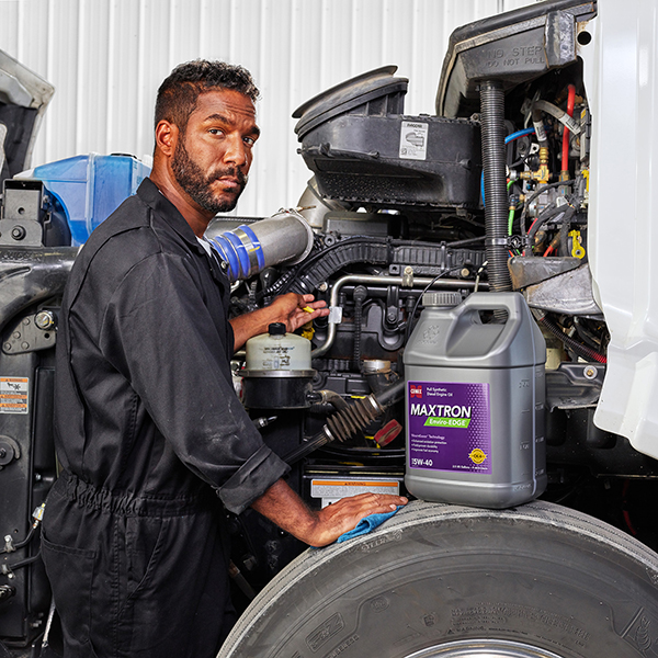 Trucker filling engine with Maxtron Enviro Edge lubricant